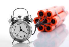 Alarm clock and dynamite Stock Photos