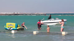 People go to the speed motorboat after banana riding in the Red Sea. Egypt Stock Footage