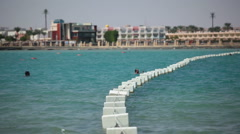 Rope with plastic buoys for safety swimming zone at the Red Sea in Egypt resort Stock Footage