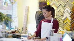 4K Cheerful business partners standing behind counter & looking at the accounts - stock footage