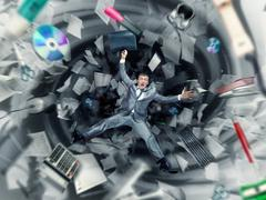 Scared businessman is falling into office chaos Stock Photos