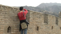 Chinese tourist taking photos on Great Wall Stock Footage