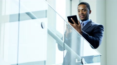 Ambitious African American businessman using wireless tablet in city office - stock footage