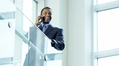 Male African American business manager using touch screen smart phone - stock footage