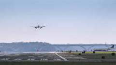 Plane Lands and Taxis Down the Runway Stock Footage