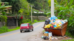 Small town sideroad with trash deposit in Brazil Stock Footage