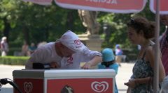 Man selling ice cream at Saxon Garden, on a sunny day in Warsaw Stock Footage
