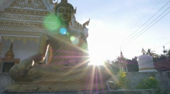 Golden Buddha in Temple against Sunset, Thailand Stock Footage