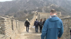 Tourists walking on Great Wall of China Stock Footage