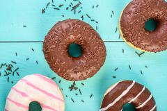 Chocolate Donuts On Blue Background - stock photo