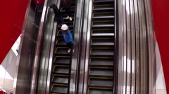 Escalators inside Target store at Metropolis shopping mall Stock Footage