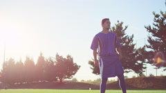 A soccer player on the field getting ready to play Stock Footage