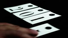 Man playing with cards with number on black table, happy New Year, 2016 Stock Footage