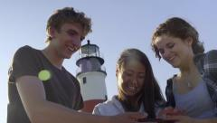 Happy Multiethnic Teens Look At Their Vacation Photos On A Smart Phone Stock Footage