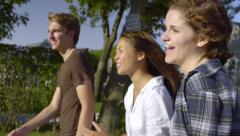 Teenagers Laugh/Talk And Walk Around Neighborhood On A Summer Day Stock Footage