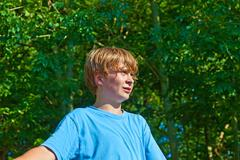 cute boy sweating after outdoor sports in nature - stock photo