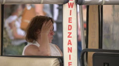 Woman sitting at an outdoor restaurant in Warsaw Stock Footage