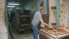 Local men working in a bakery in old city of the Jerusalem in Israel Stock Footage