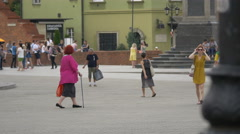 People walking in Castle Square, Warsaw Stock Footage