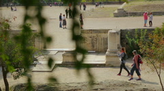 Many tourists go sightseeing around ruins of ancient building, summer vacation Stock Footage