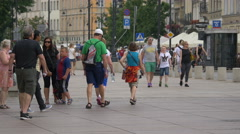 People of all ages walking on Krakowskie Przedmiescie street, Warsaw Stock Footage