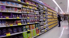 Woman choosing detergent inside London drugs store Stock Footage