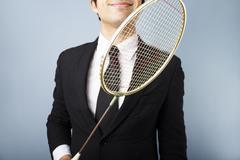 Businessman with badminton racket Stock Photos