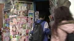 Buying newspaper, Beijing, China Stock Footage