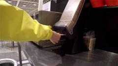 Woman taking napkin at food court area inside Ikea store Stock Footage