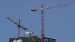 Two tower cranes on a blue sky backgroung in Warsaw Stock Footage