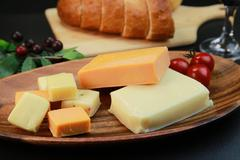Assorted cheeses Stock Photos
