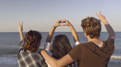 Multiethnic Teens Hold Up Peace Signs And Heart Shape Symbol Stock Footage