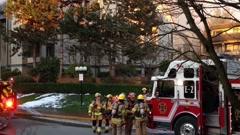 Firefighter crews battling apartment complex fire Stock Footage