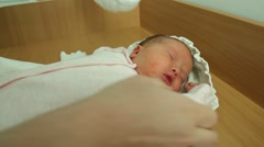 Mom's Hands on Dress Clothes Baby Girl Stock Footage