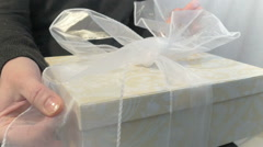 Unpacking a present - stock footage