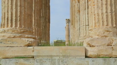 Vertical pan shot of Zeus Temple columns crowned with sophisticated capitals Stock Footage