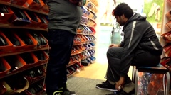 People trying new shoes at shoe store - stock footage