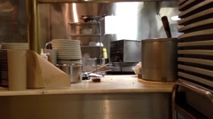 Boiling pork soup in the pot inside a restaurant kitchen. - stock footage