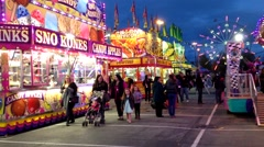 Night shot of people having fun at the West Coast Amusements Carnival Stock Footage