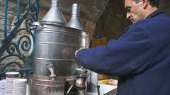 Local man making the coffee in old city of the Jerusalem in Israel - stock footage