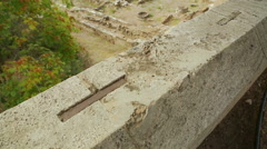 Top view of archaeology excavations site, remains of stone building foundation Stock Footage