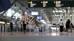 Passengers with luggage inside YVR airport Stock Footage