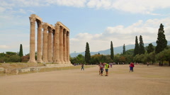 Tourists on summer vacation in Greece, photographing ancient columns in Athens Stock Footage