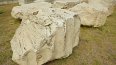 Pieces of stone, ancient marble construction ruins in excavation area, history Stock Footage
