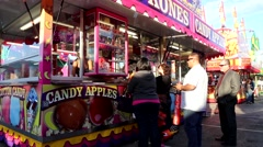 Candy apples booth at Coast Amusements Carnival - stock footage