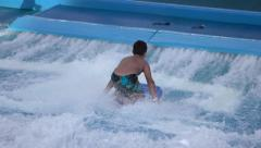 Grand Cayman cruise ship boy knee board surfing 4K Stock Footage