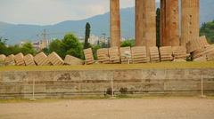 Remains of ancient Olympian Zeus Temple corner, modern Athens in background Stock Footage
