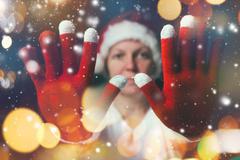 Stop the celebration, beautiful woman in Santa Claus costume Stock Photos