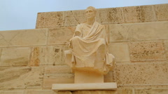 Antique statue of public figure at Theater of Dionysus in Athens, Greek culture Stock Footage