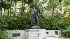 King George VI bronze statue at Hong Kong park, view move around Stock Footage